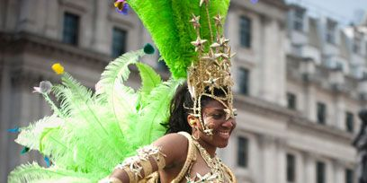 Entertainment, Performing arts, Event, Samba, Dancer, Carnival, Abdomen, Headgear, Trunk, Street performance,