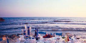 Textile, Furniture, Tablecloth, Table, Ocean, Linens, Chair, Horizon, Outdoor furniture, Sea,