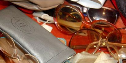 Eyewear, Vision care, Goggles, Glass, Personal protective equipment, Sunglasses, Amber, Eye glass accessory, Reflection, Transparent material,