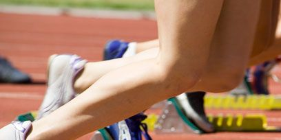 Track and field athletics, Grass, Shoe, Sport venue, Human leg, Joint, Athletic shoe, Sportswear, Running, Athlete,