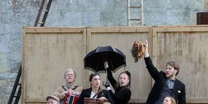 Mammal, Stairs, Flag, Fur, Umbrella, Folk instrument, Ladder, Costume, Free reed aerophone, Boot,
