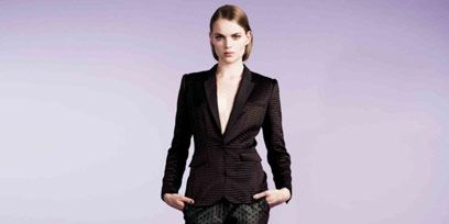 Clothing, Leg, Sleeve, Collar, Human body, Shoulder, Textile, Joint, Standing, Outerwear,