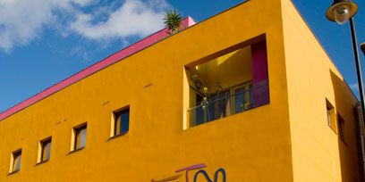 Yellow, Facade, Building, Wall, Amber, Colorfulness, House, Street light, Door, Stairs,