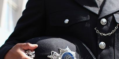 Collar, Sleeve, Dress shirt, Badge, Blazer, Uniform, Logo, Button, Embellishment, Pocket,