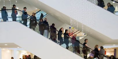 People, Social group, Stairs, Crowd, Retail, Shopping mall, Handrail, Customer, Commercial building, Escalator,