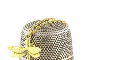 Fashion accessory, Headgear, Costume accessory, Metal, Brass, Costume hat, Bronze, Silver, Body jewelry, Headpiece,