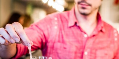 Glass, Shirt, Drinkware, Tableware, Dress shirt, Drink, Stemware, Cocktail, Barware, Champagne stemware,
