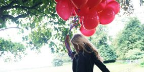 Balloon, People in nature, Dress, Party supply, Long hair, Day dress, Fence, One-piece garment,