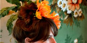 Hairstyle, Orange, Petal, Flower, Hair accessory, Style, Headpiece, Headgear, Fashion accessory, Sleeveless shirt,