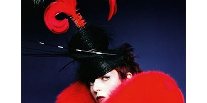 Red, Fur clothing, Costume accessory, Costume, Animal product, Natural material, Fur, Feather, Costume hat, Velvet,