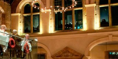 Lighting, Interior design, Holiday, Interior design, Hall, Christmas decoration, Light fixture, Christmas, Column, Ornament,