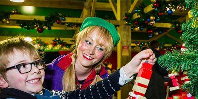 Smile, Event, Christmas decoration, Happy, Christmas, Christmas ornament, Interior design, Christmas eve, Holiday, Costume accessory,