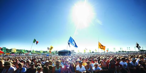 Crowd, People, Audience, Hat, Sun, Flag, Headgear, Fan, Public event, Lens flare,