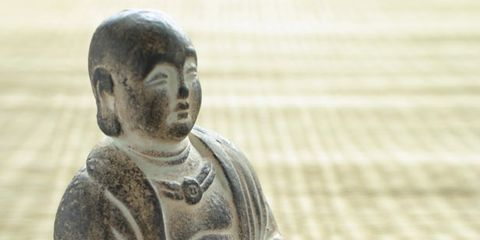 Cheek, Sculpture, Sitting, Artifact, Carving, Statue, Stone carving, Creative arts, Figurine, Nonbuilding structure,