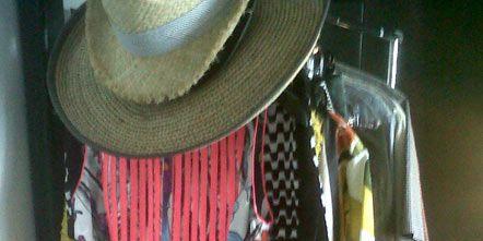 Hat, Textile, Sun hat, Human settlement, Fedora, Clothes hanger, Wool, Fashion design, Thread, Cowboy hat,