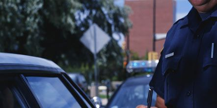 Finger, Automotive exterior, Vehicle door, Glass, Police, Cap, Wrist, Windshield, Law enforcement, Police officer,