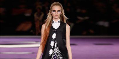 Clothing, Fashion show, Dress, Outerwear, Purple, Style, Runway, Formal wear, Fashion model, Street fashion,