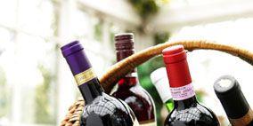 Glass bottle, Bottle, Drink, Alcoholic beverage, Alcohol, Wine bottle, Drinkware, Basket, Distilled beverage, Barware,