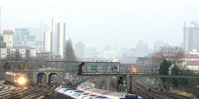 Mode of transport, Transport, Track, Rolling stock, Railway, Urban area, Tower block, Locomotive, Train, Metropolitan area,