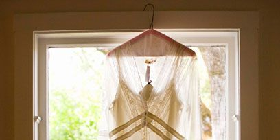 Wood, Interior design, Textile, Fixture, Clothes hanger, Tints and shades, Window treatment, Beige, Shade, Light fixture,