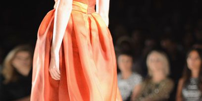 Fashion show, Shoulder, Joint, Orange, Runway, Style, Fashion model, Amber, Fashion, Haute couture,