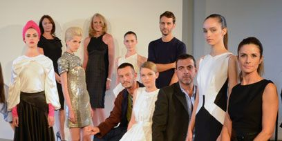 Clothing, Footwear, Face, People, Event, Trousers, Dress, Social group, Coat, Shoe,