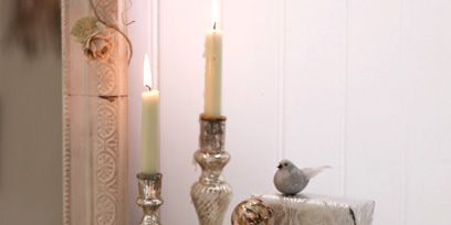 Interior design, Toy, Still life photography, Candle, Bird, Doll, Candle holder, Peach, Feather, Natural material,