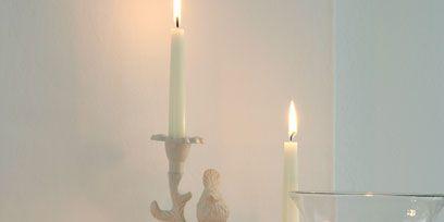 Lighting, Petal, Flower, Wax, Centrepiece, Candle holder, Candle, Interior design, Bouquet, Glass,