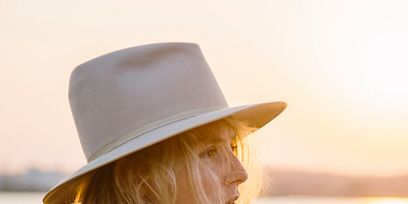 Clothing, Lip, Brown, Hairstyle, Hat, Shoulder, Photograph, Style, Fashion accessory, Headgear,