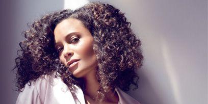 Lip, Jheri curl, Hairstyle, Sleeve, Shoulder, Ringlet, Jewellery, Style, Black hair, Fashion model,