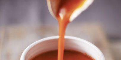 Liquid, Serveware, Drinkware, Cup, Drink, Coffee cup, Orange, Ingredient, Peach, Dishware,