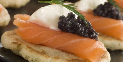 Smoked salmon blinis with crème fraiche and caviar