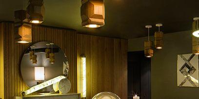 Lighting, Room, Interior design, Table, Interior design, Wall, Lighting accessory, Light fixture, Lamp, Electricity,