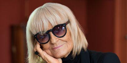 Eyewear, Glasses, Vision care, Sunglasses, Outerwear, Bangs, Blond, Street fashion, Blazer, Employment,