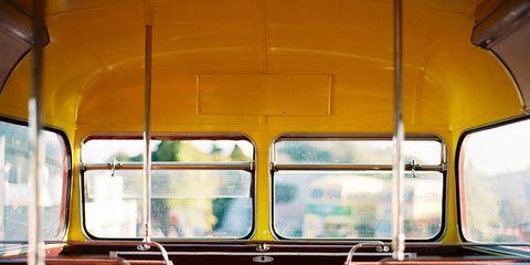 Mode of transport, Transport, Glass, Public transport, Amber, Light, Orange, Tints and shades, Automotive window part, Symmetry,