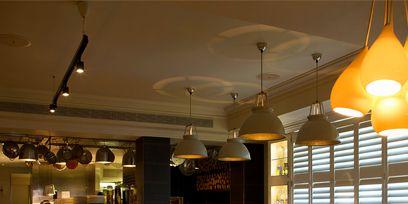 Lighting, Interior design, Room, Floor, Ceiling, Ceiling fixture, Furniture, Light fixture, Couch, Interior design,