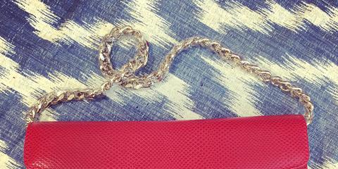Textile, Red, Carmine, Pattern, Symbol, Electric blue, Material property, Bag, Emblem, Stitch,