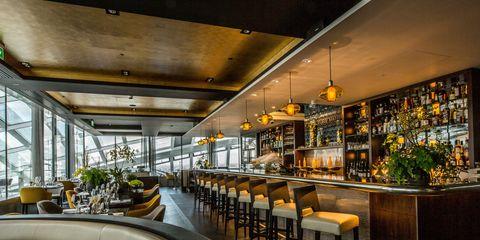 Lighting, Interior design, Glass, Ceiling, Barware, Light fixture, Houseplant, Interior design, Drinking establishment, Couch,
