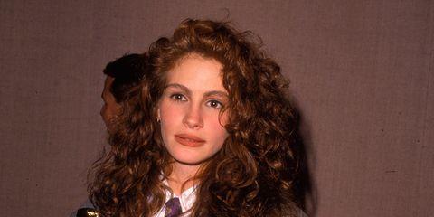 Hand, Ringlet, Jheri curl, Drink, Blazer, Brown hair, Long hair, Hair coloring, Button, Layered hair,