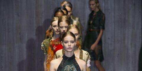 Leg, Human body, Fashion show, Dress, Shoulder, Joint, Runway, Style, Fashion model, One-piece garment,