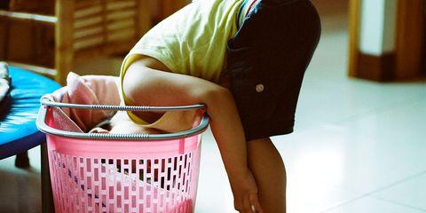 Floor, Flooring, Basket, Foot, Storage basket, Barefoot, Toe, Wicker, Laundry basket, Ankle,