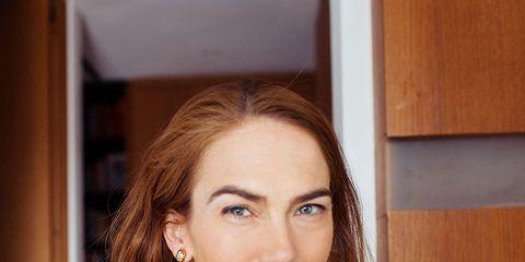 Hair, Earrings, Hairstyle, Eyebrow, Eyelash, Style, Jewellery, Beauty, Wood stain, Long hair,