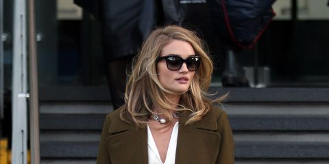 Clothing, Eyewear, Brown, Coat, Sleeve, Sunglasses, Textile, Joint, Outerwear, Fashion accessory,