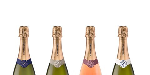 Product, Liquid, Bottle, Glass bottle, Drink, Logo, Label, Bottle cap, Brand, Peach,