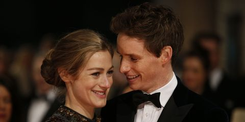 Ear, Coat, Hairstyle, Collar, Outerwear, Suit, Happy, Formal wear, Facial expression, Style,