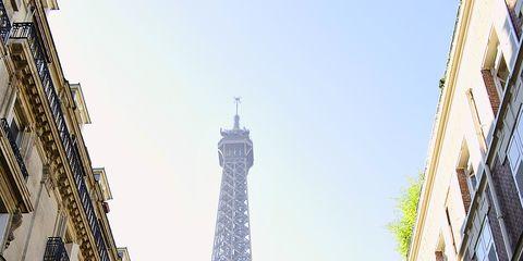 Daytime, Architecture, Yellow, Urban area, Tower, Metropolitan area, Metropolis, Facade, City, Landmark,