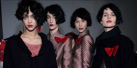 Hairstyle, Textile, Costume, Black hair, Wig, Headgear, Costume accessory, Fashion, Fur, Bag,