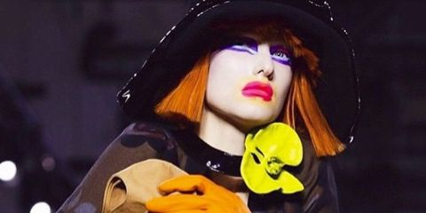 Hand, Costume accessory, Costume, Costume hat, Witch hat, Costume design, Toy, Earrings,