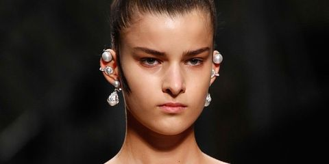 Clothing, Ear, Lip, Earrings, Hairstyle, Shoulder, Eyelash, Style, Strapless dress, Beauty,