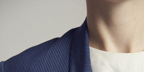 Collar, Sleeve, Dress shirt, Textile, Joint, Formal wear, Logo, Blazer, Carmine, Fashion,
